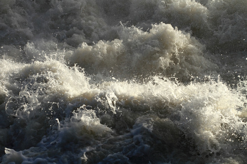 Very choppy whitewater waves in the rapids of the Bow River, Alberta, Canada