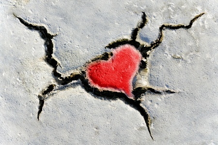 10485016 - natural red heart shape in cracked dry soil