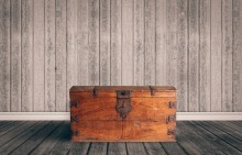 35807718 - old wooden chest with closed lit