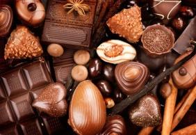 38253343 - chocolates background. praline chocolate sweets