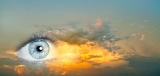 42165959 - female clear eye on blue sky background