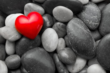 49481814 - red stone heart on other stones