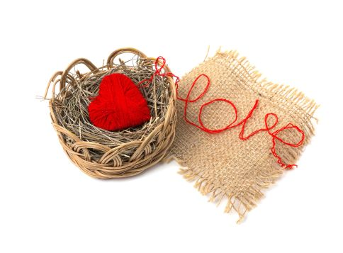 51685035 - heart of yarn in a wicker basket isolated on white background