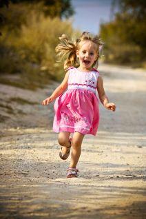 37781257 - running open arms little happy girl green meadow field track