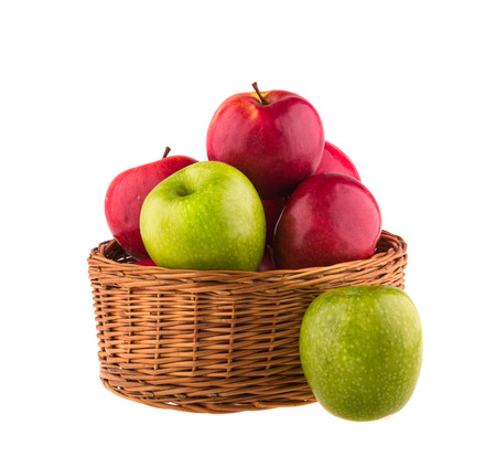 27362990 - red and green apples in a wooden basket on white background.