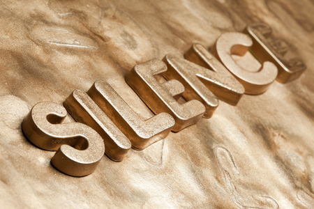 64679908 - golden silence 3d text