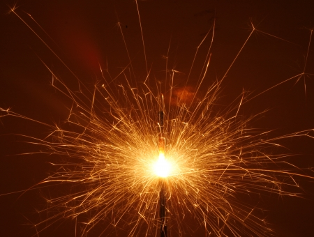 25236188 - bengal fire. christmas sparkler isolated on black background